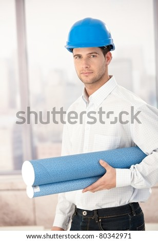 Handsome young architect wearing hardhat.? - stock photo