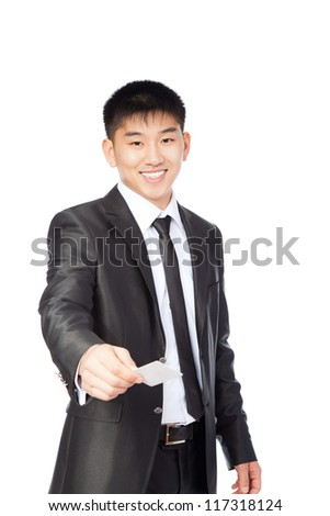 Handsome young asian business man hold empty visit or credit business card, businessman happy smile, wear elegant suit and tie isolated over white background - stock photo