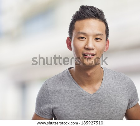handsome young asian man face, closeup photo - stock photo