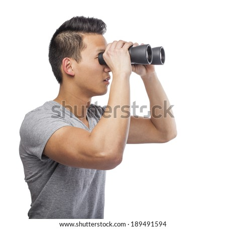 handsome young asian man looking through a binoculars