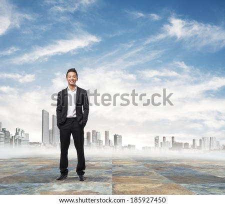 handsome young asian man standing in front of the city