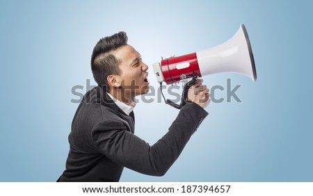 handsome young asian man with a megaphone