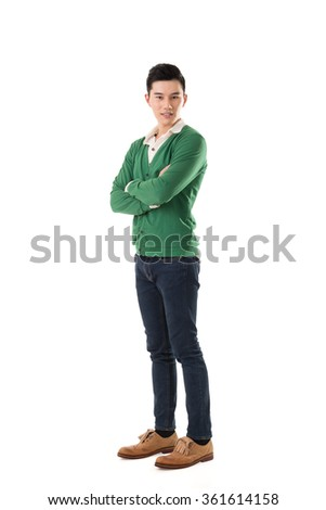 Handsome young Asian man with sweater, full length portrait isolated. - stock photo