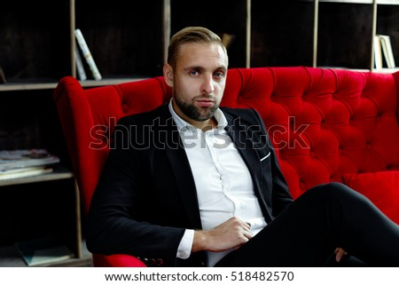 handsome young bearded man posing in studio