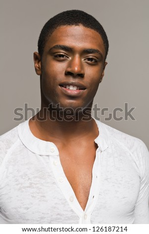 Handsome young black man in a casual white shirt