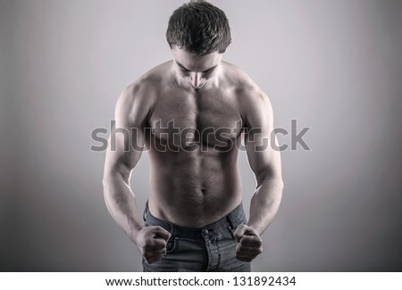 Handsome young bodybuilder posing