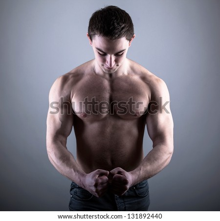 Handsome young bodybuilder posing - stock photo