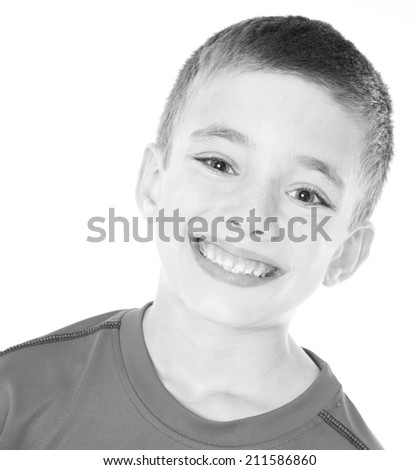 Handsome young boy blank and white headshot isolated on white background - stock photo