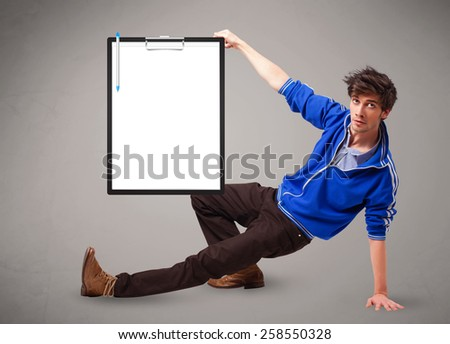 Handsome young boy holding black folder with white sheet copy space - stock photo