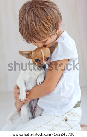 Handsome Young Boy Playing with His Dog  - stock photo