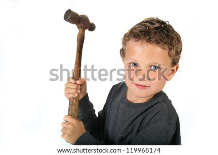 Handsome young boy with hammer isolated on white background - stock photo