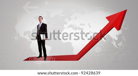 Handsome young business man and laptop  with a red graph  upwards - stock photo