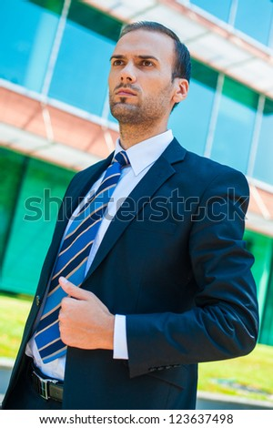 handsome young business man at office building - stock photo