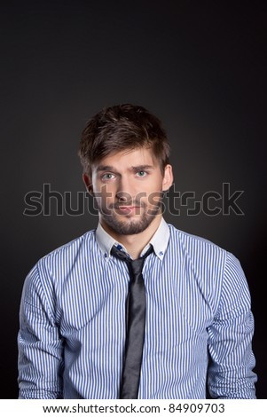 Handsome young business man doubt, over black background. series of portrait photos - stock photo