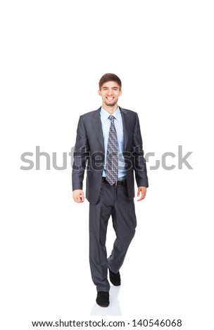 Handsome young business man go walk making step up happy smile, businessman wear elegant gray suit and tie full length portrait isolated over white background