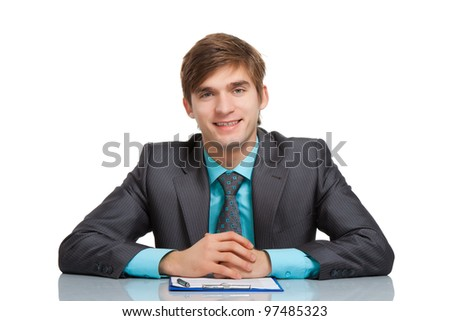 Handsome young business man happy smile, businessman sitting at the desk at office working with documents sign up contract, wear elegant suit and tie isolated over white background - stock photo