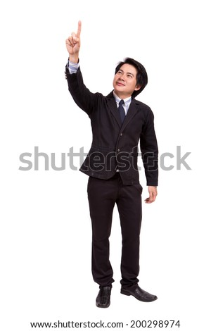 Handsome young business man happy smile point finger to empty copy space - stock photo