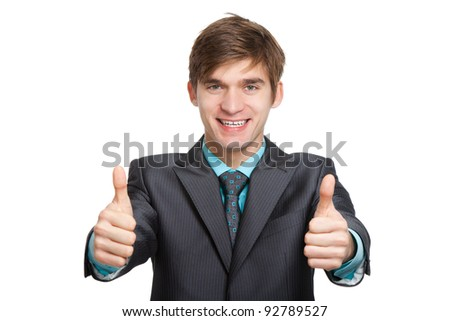 Handsome young business man hold two hands with thumb up gesture, businessman happy smile, wear elegant suit and tie isolated over white background - stock photo