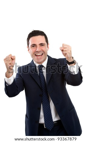 Handsome young business man in blue suit expressing a cry for victory. Isolated on white. - stock photo