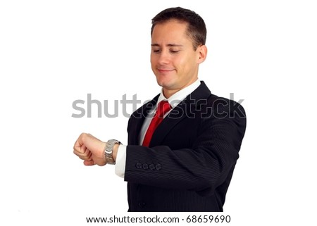 Handsome young business man looking at his watch