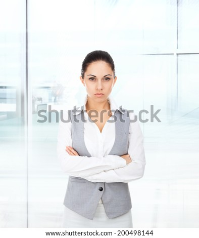 Handsome young business man serious, businessman folded hands in modern office - stock photo