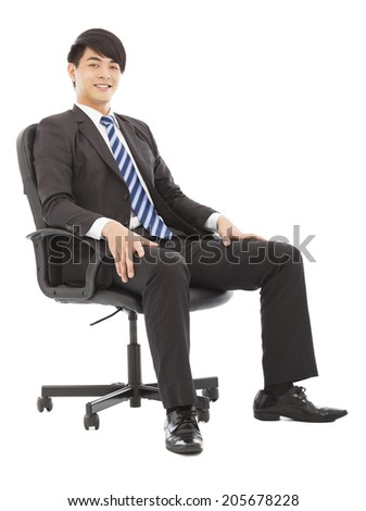 handsome  Young business man sitting on a chair
