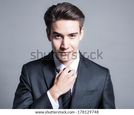 Handsome young business man smiling - stock photo