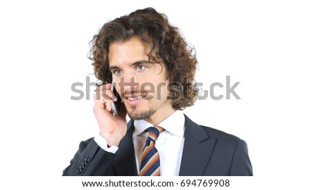 Handsome young business man talking on smartphone smiling happy