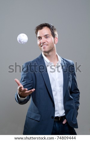 Handsome young business man with a baseball and smile