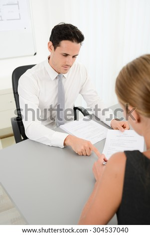handsome young business man with customer in office signing agreement sales contract - stock photo