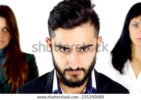 Handsome young business man with gorgeous ladies looking to him - stock photo