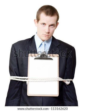 Handsome young business person dangling a carrot on a string from his mouth conceptual of offering an incentive bonus as a reward for harder work - stock photo