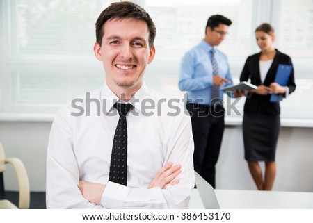 Handsome young businessman at the office. - stock photo