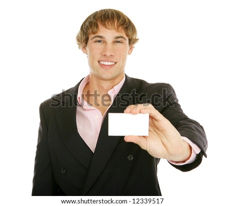 Handsome young businessman holding out his business card.  Card is blank for your text.  Isolated on white. - stock photo