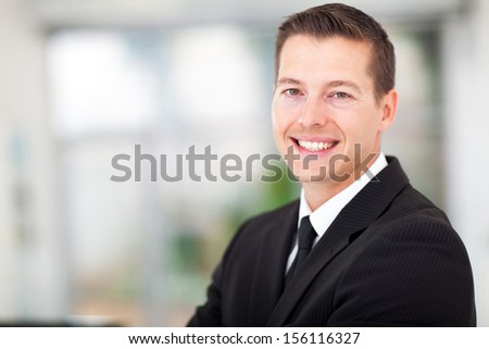 handsome young  businessman in a black suit