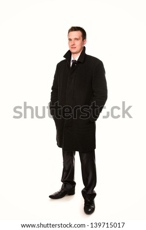 Handsome young businessman in a coat  isolated on white