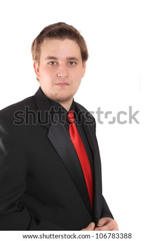 Handsome young businessman in black formal suit with red tie