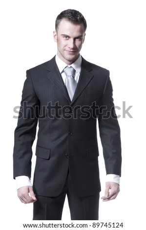Handsome young businessman in black suit and grey necktie isolated on white background