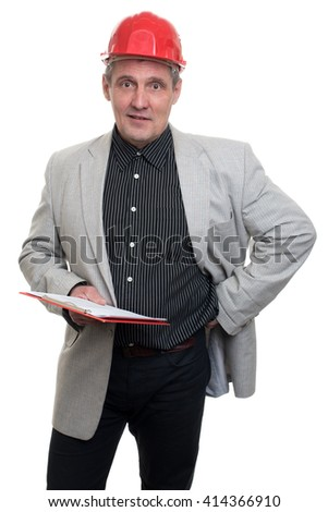 Handsome young businessman in classic suit and orange helmet smiling, holding a folder  - stock photo