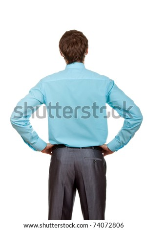 Handsome young businessman isolated over white background, standing and thinking