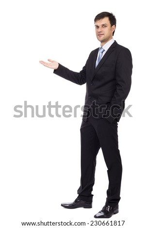 Handsome young businessman making welcome gesture isolated over white background