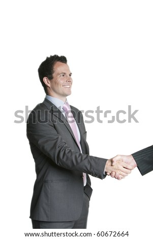 Handsome young businessman shaking hands - stock photo