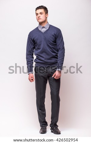 Handsome young businessman  standing against white background - stock photo