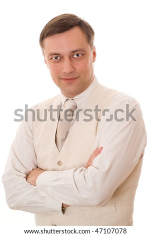 handsome young businessman standing and smiling on white