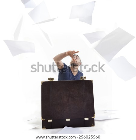 handsome young businessman throws sheets in the air - stock photo