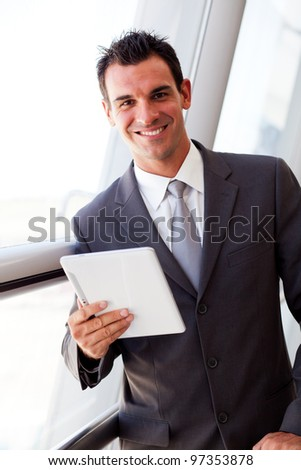 handsome young businessman using tablet computer - stock photo