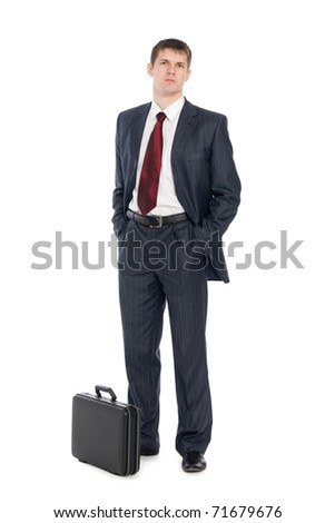 Handsome young businessman with a suitcase. - stock photo