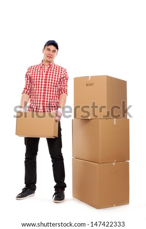 Handsome young caucasian courier with brown box isolated over white background