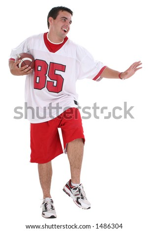 Handsome young college man with football. Wearing football jersey. Full body over white. Clipping path included.