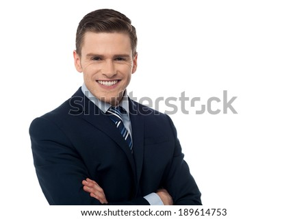 Handsome young corporate guy with arms crossed